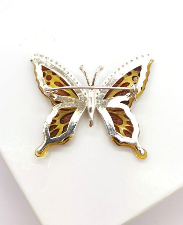 gintarinė sagė drugelis